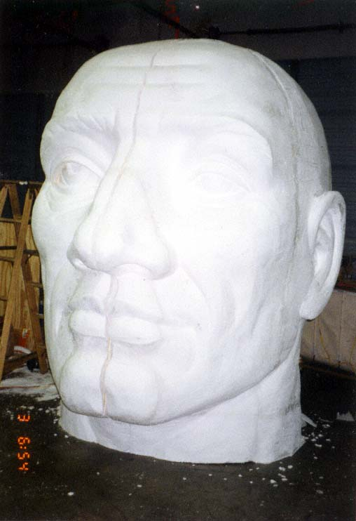 13 foot styrofoam head covered with Sculpt or Coat